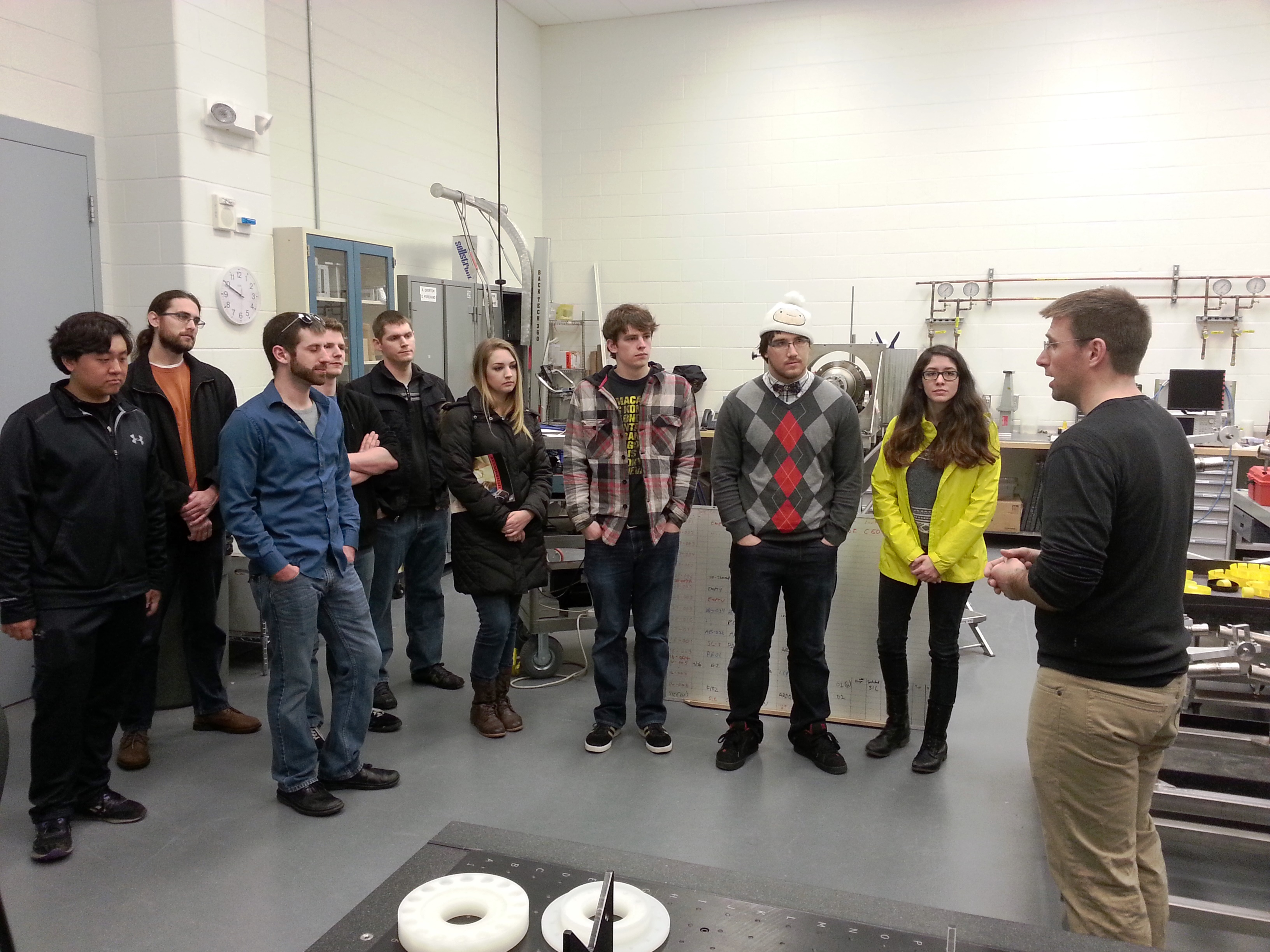 Ari Palczewski speaks with Temple Physics Society students during a tour of the lab in March 2015.