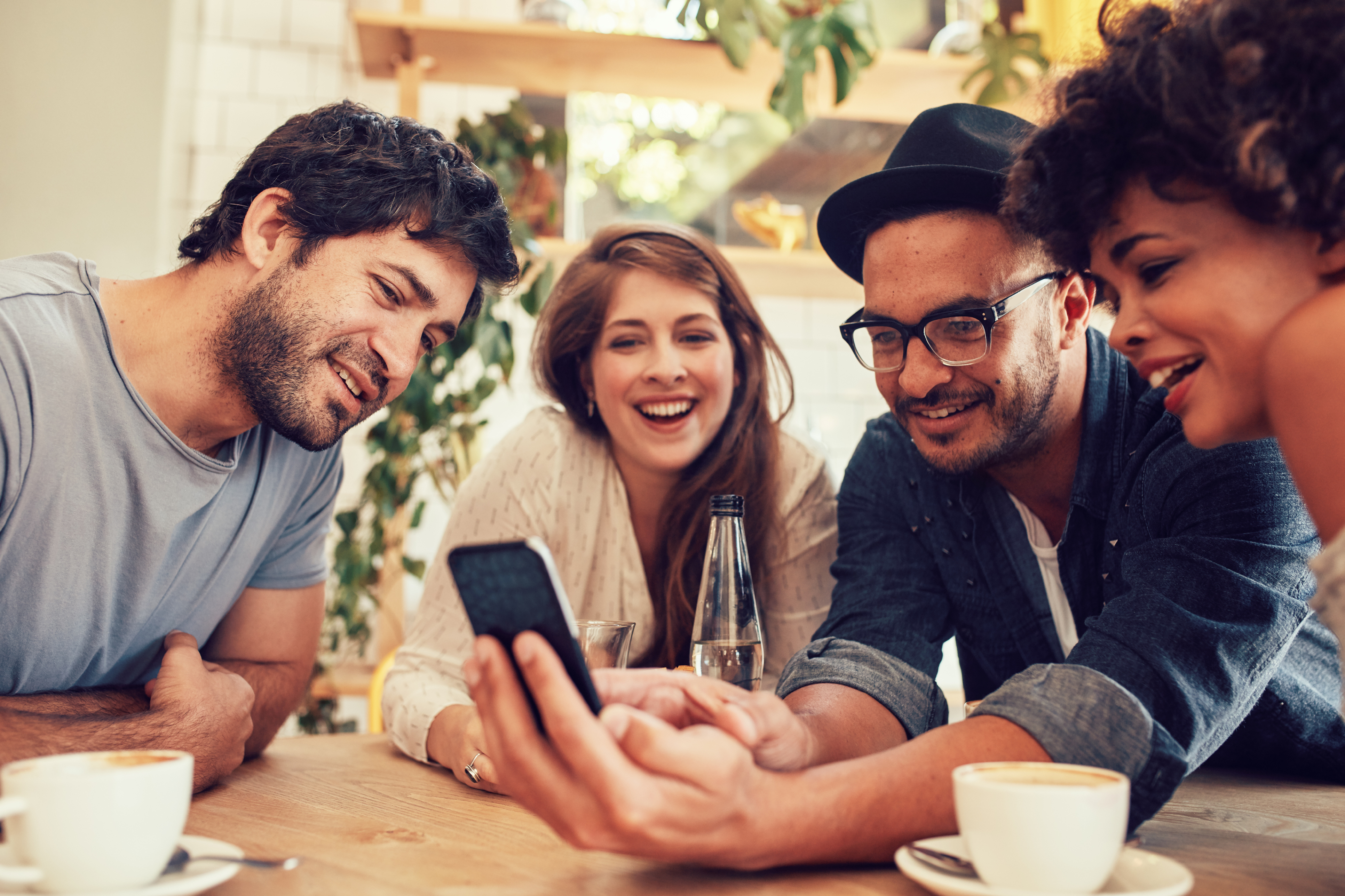 Group of diverse people looking at smartphone