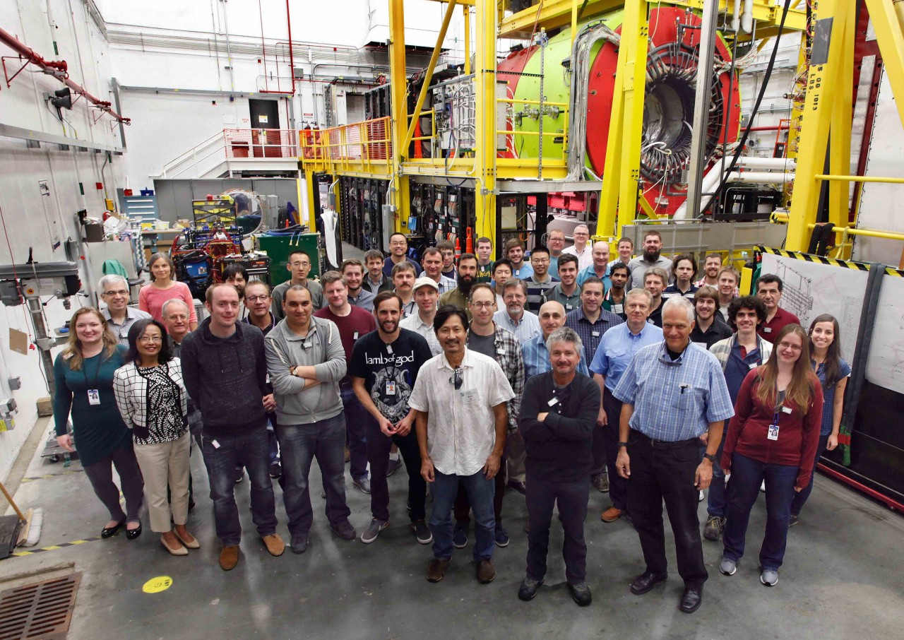 Hall D collaboration members pose in front of the experimental apparatus