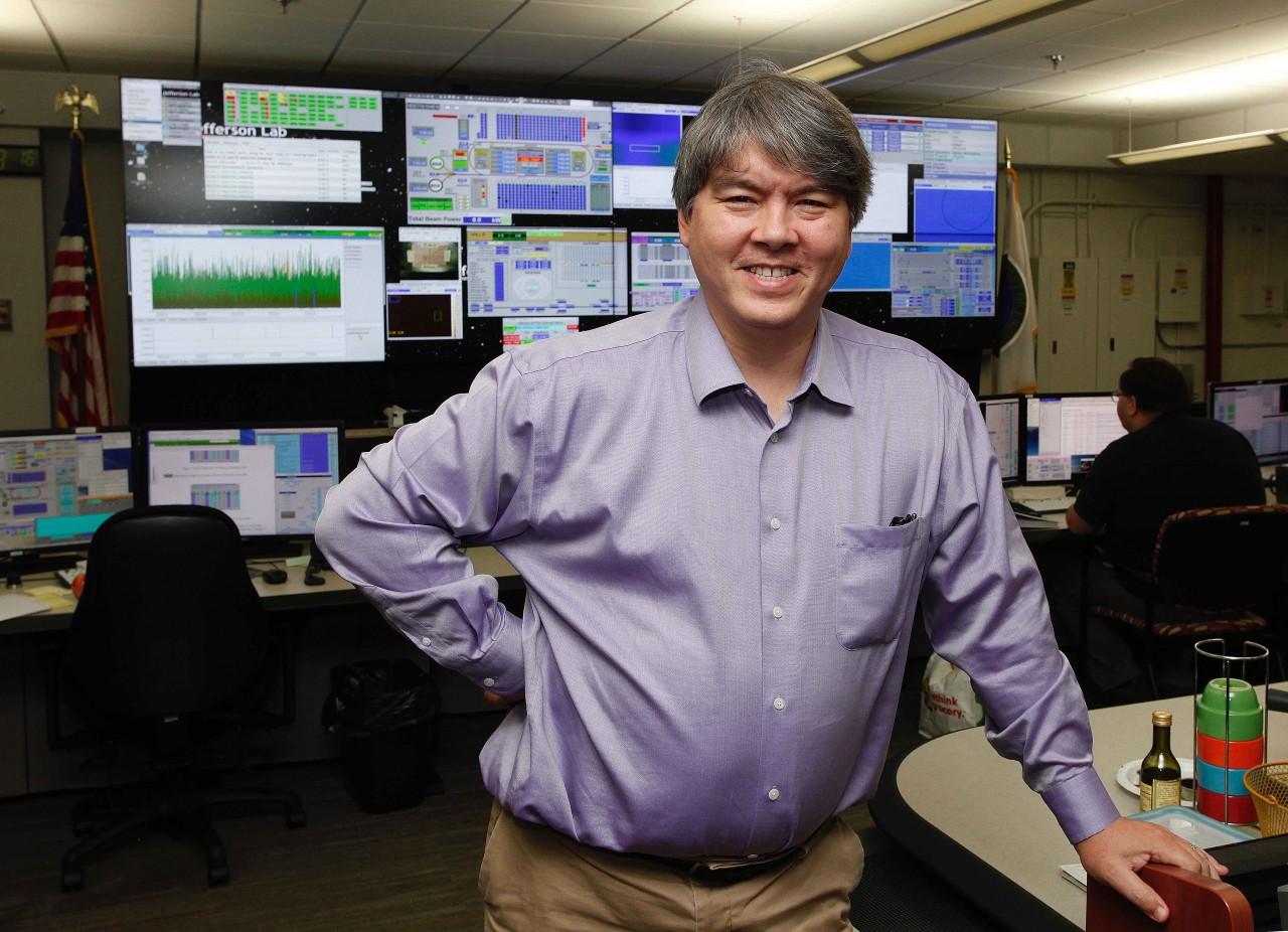 Todd Satogata shown in the CEBAF control room