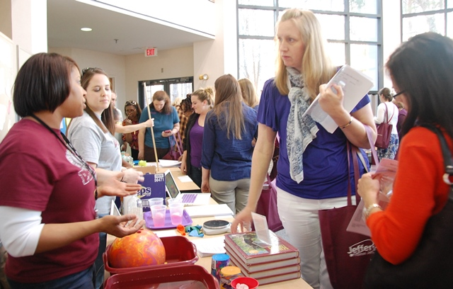 Teachers discuss an activity at Teacher Night 2018