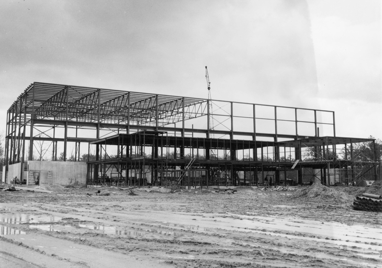 B&W photo of framework of building under construction in 1964