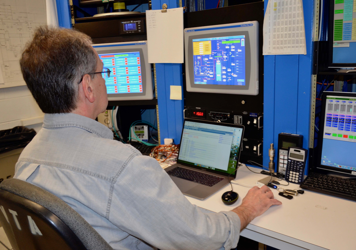 Control Room of Vertical Test Area, showing Pete Kushnick at the controls.