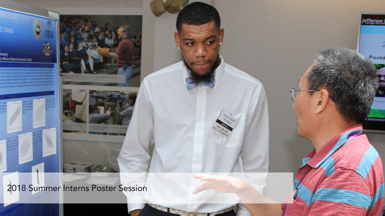 A student presents a poster during the 2018 Summer Intern Poster Session