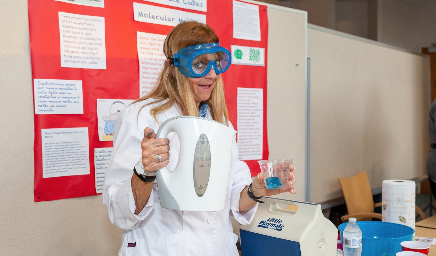 A teacher uses an hot water kettle and gelatin for a science demo