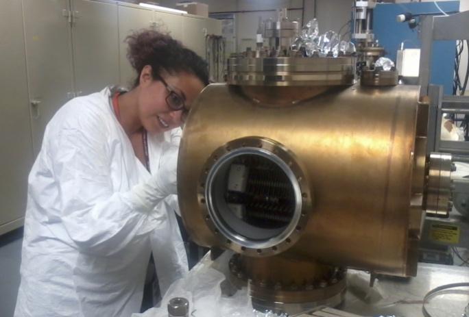 Program participant Anahi Segovia working on a vacuum chamber