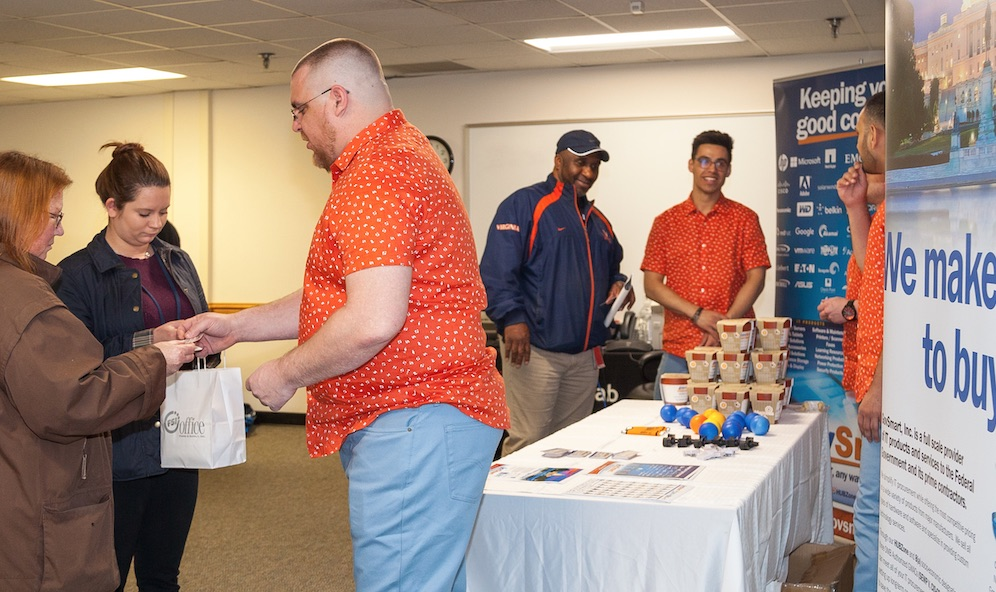 Photo of lab staff interacting with a vendor at the Vendor Fair 2018