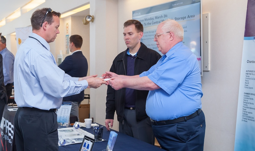 Photo of a lab staff member interacting with a vendor at the Vendor Fair 2018