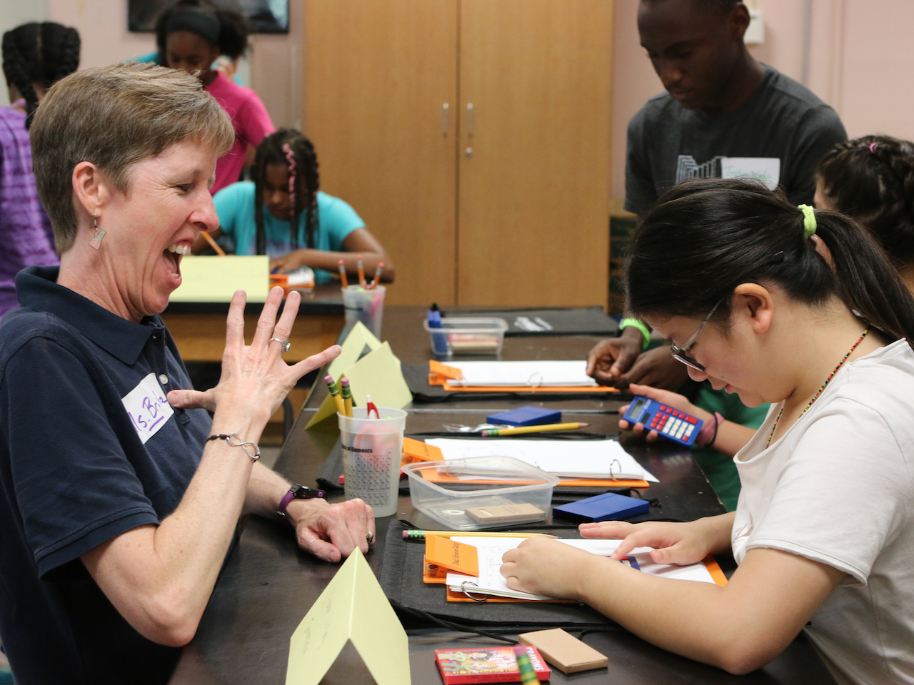 Deaf Science Camp Founder Brita Hampton works with a student at the 2019 Deaf Science Camp