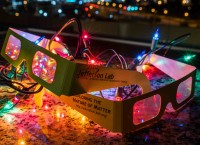 JLab's diffraction grating glasses with holiday light spectra visible