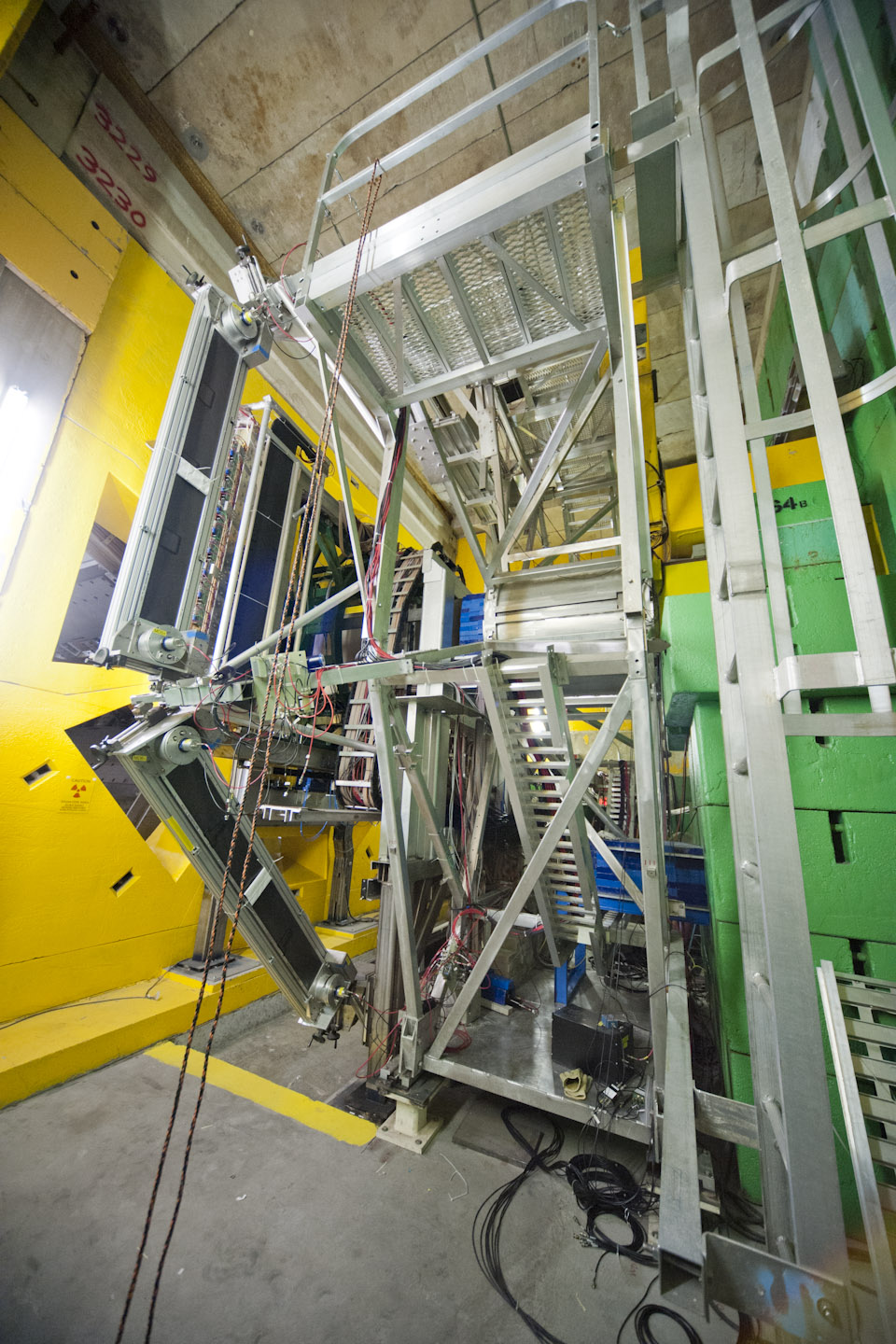 yellow and green radiation shield blocks flank Q-weak detectors