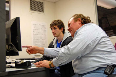 Lucas Thomeer puts finishing touches on the robot CAD design with help from JLab Staffer Jim Henry.