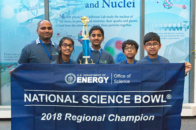 Taking home first place was the team from Rachel Carson Middle School, Herndon. Pictured, left to right is Coach Sudhir Duggineni, and team members Shruti Kamasamudram, Om Duggineni, Deccan Maniam and Srihan Kotnana
