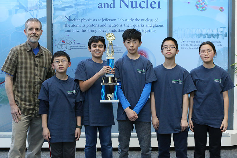 Finishing in second was the team from Longfellow Middle School, Falls Church. Pictured, left to right, is Coach Jim Bradford, and team members Daniel Lian, Owen Rollins, Kendall Sano, William Jiang and Audrey Yin.