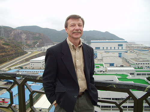 The Daya Bay and Ling Ao nuclear power reactors, pictured here behind Bob McKeown, are located roughly 55 kilometers from Hong Kong.