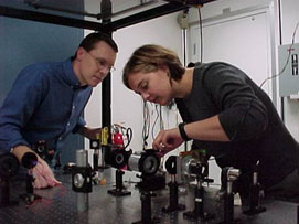 Kent Paschke (Carnegie Mellon University) and Lisa Kaufman (University of Massachusetts Amherst) helped improve the polarized electron beam for use in the Hall A Proton Parity Experiment in 2005.