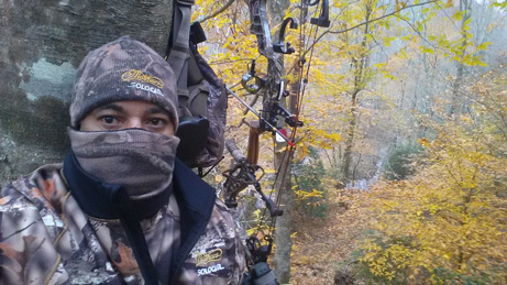 Jenord Alston bow hunting - in woods with compound bow
