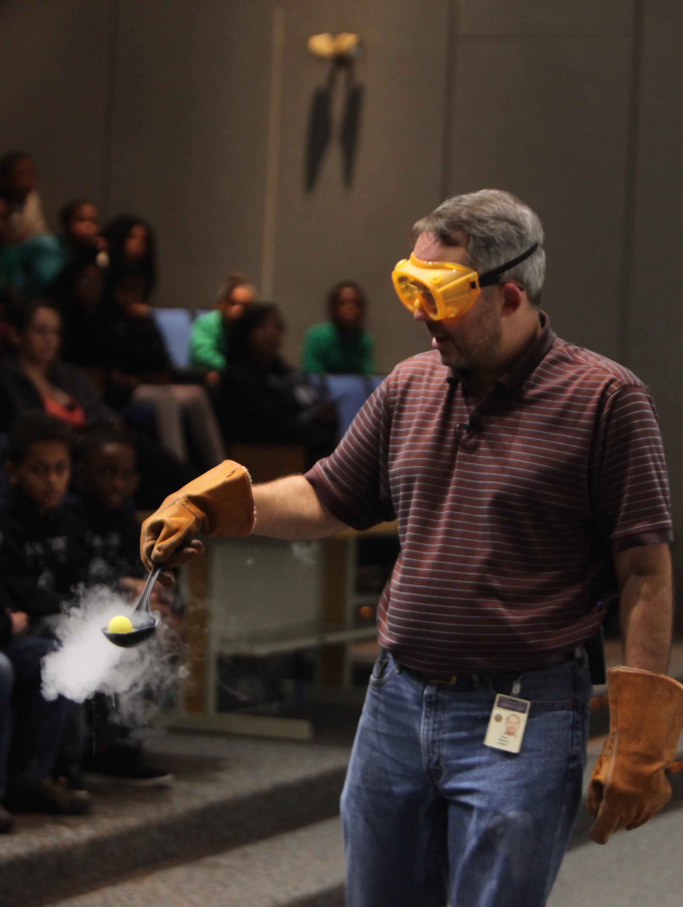 Steve Gagnon holds a ball in a ladle filled with liquid nitrogen