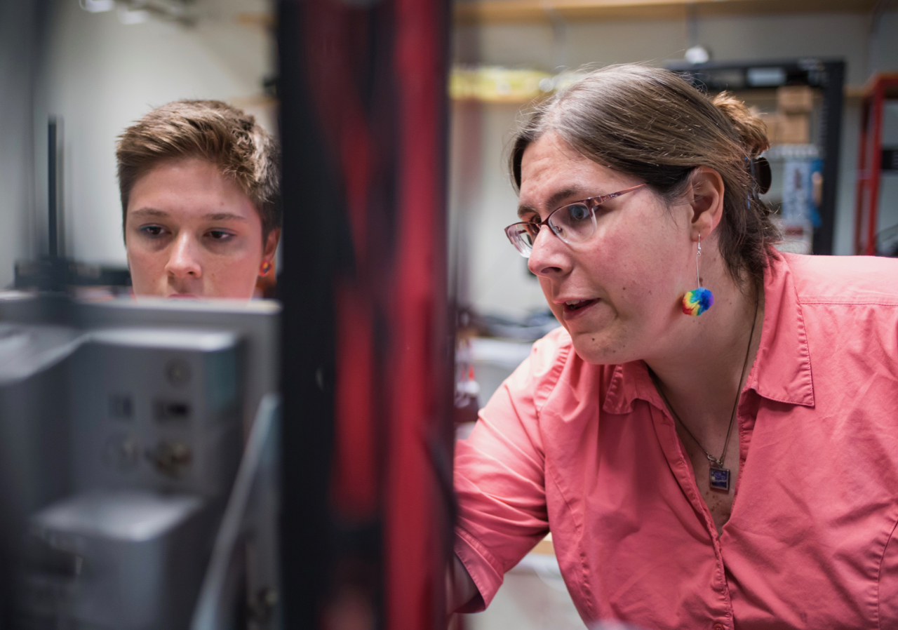 Alana Gudinas works with Elena Long in her research lab on the UNH campus