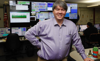 Todd Satogata shown in the CEBAF control room