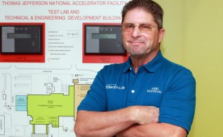 Tim Minga in front of a fire protection system panel