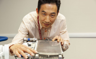 Seungjoon Lee is shown with the VASH collimator he developed.