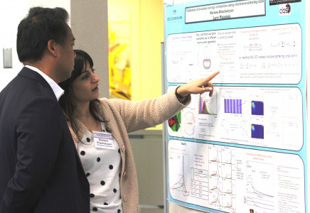 Student Explaining Poster During Poster Session