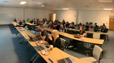 Graduate students attend a lunchtime seminar the 2019 JLUO meeting