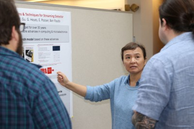 A scientist presents a poster on the results of her LDRD project