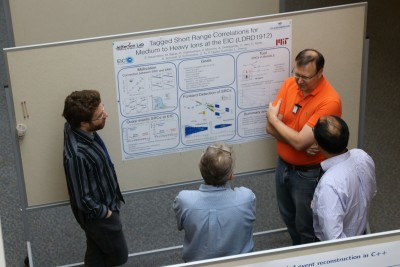 A principal investigator presents a poster on the results of his LDRD project