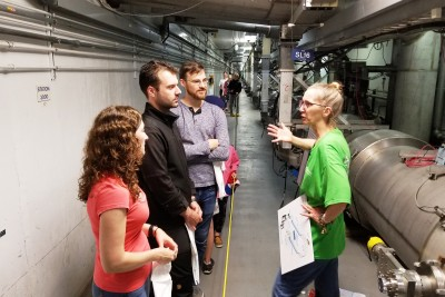 Members of the JLab community interact with the public at the Open House in 2018 - CEBAF Accelerator Tunnel