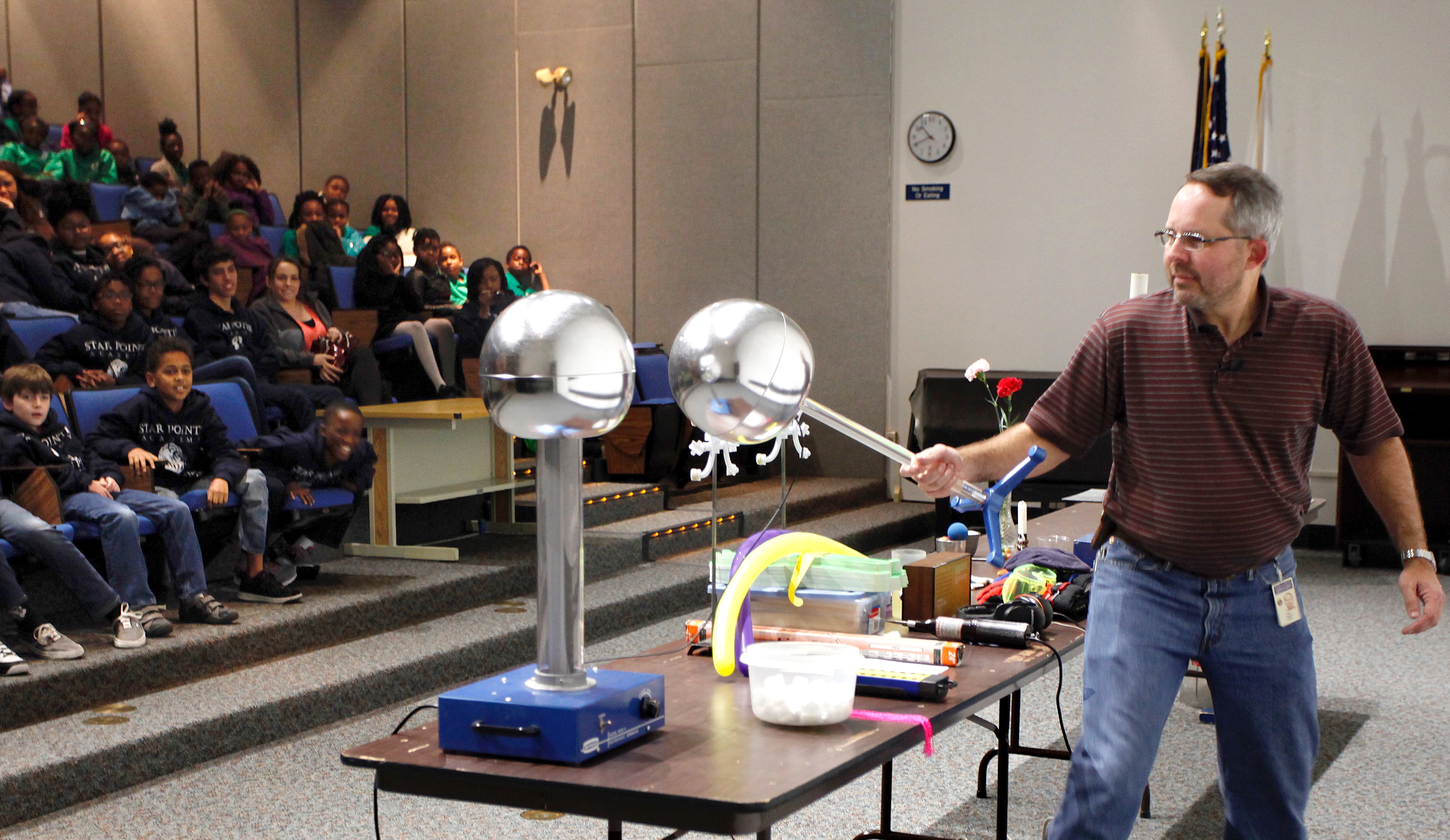"Jefferson Lab's Steve Gagnon prepares to give an ""electrifying"" demonstration, using a Van de Graff generator during a Physics Fest program."